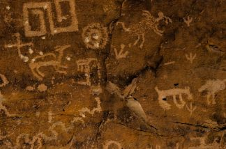 A grouping of petroglyphs etched into desert varnish. (Photo: Brian Alford)