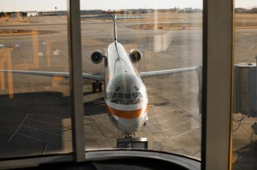 A passenger jet as seen through an airport window. (Photo: Brian Alford)