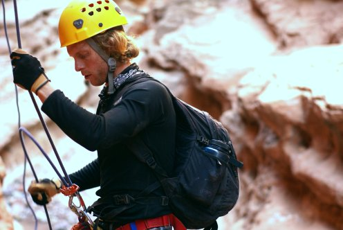 Ben Alford prepares to repel in Badger Canyon. (Photo: Mag Kim)
