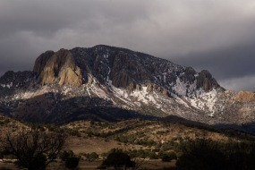 Vicks Peak, New Mexico dusted with snow and dappled with afternoon light.